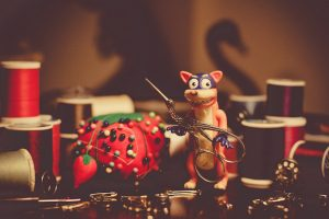 Photo of a fox figurine and a handful of sewing supplies
