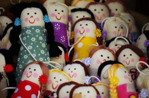 A collection of sewn dolls
