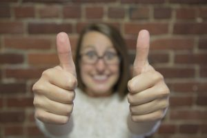 Cheerful lady showing a thumbs up gesture