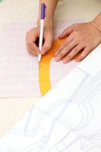 Photograph of a lady using her sewing pattern