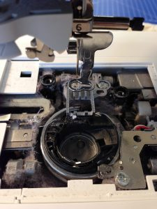 A photo of a dirty sewing machine